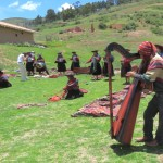 Harpist with weavers in background