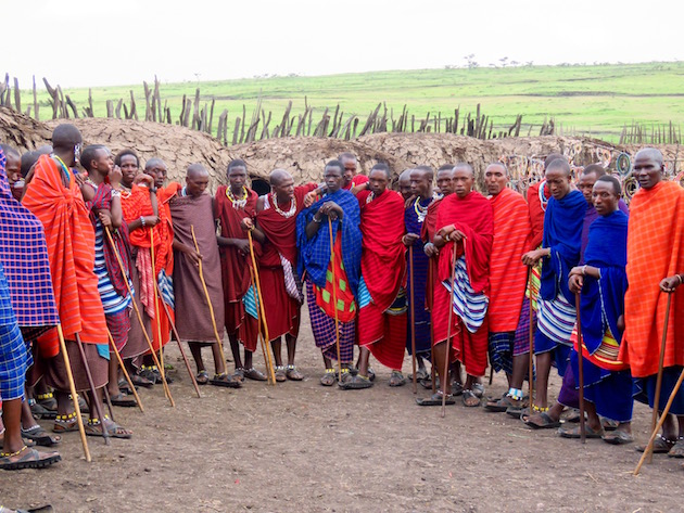 Tanzania Ngorongoro Crater Masai Men In Front Of Huts