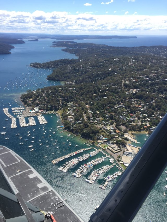 Viewed from the air, you can see some of the many bays that line Sydney Harbor, as well as a marina