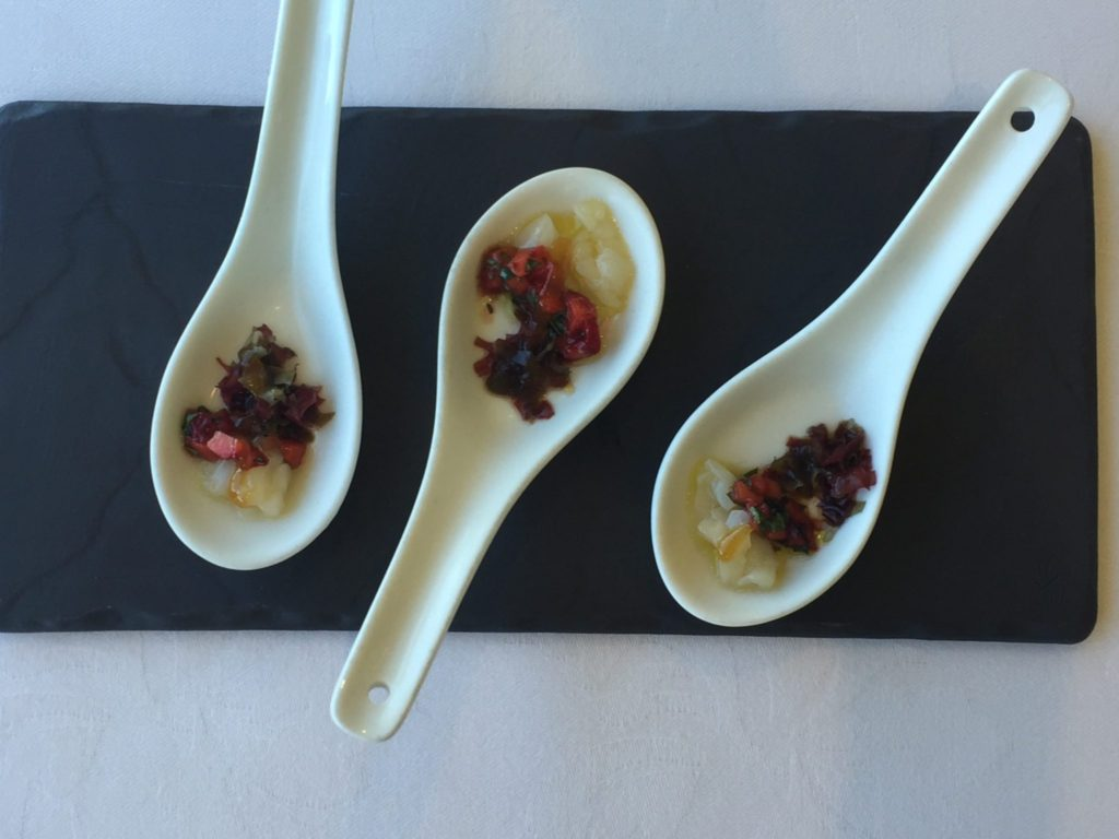 Jonah's Restaurant amuse Boucher: Creamy Scallop ceviche contrasts with deep red roasted diced strawberries, served on small white ceramic spoons